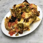 Loaded nachos- tomatoes, olives, jalapeños, chili with beans, cheese- side of salsa and sour cream